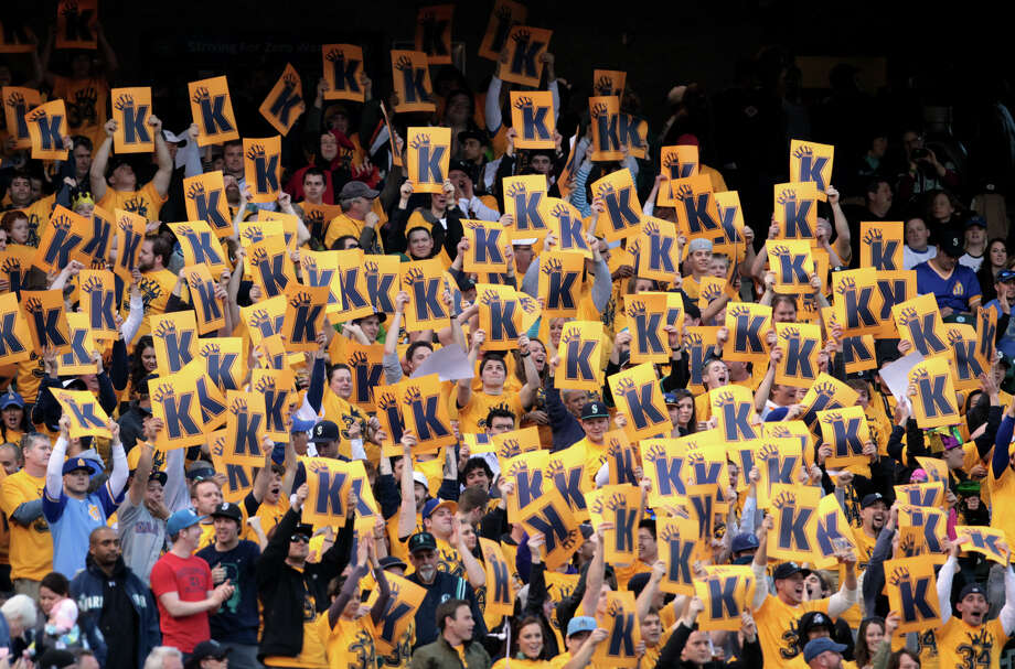 Members of the Felix Hernandez Kings Court seating area cheer as Hernandez strikes out an Oakland Athletics player. Photo: JOSHUA TRUJILLO / SEATTLEPI.COM