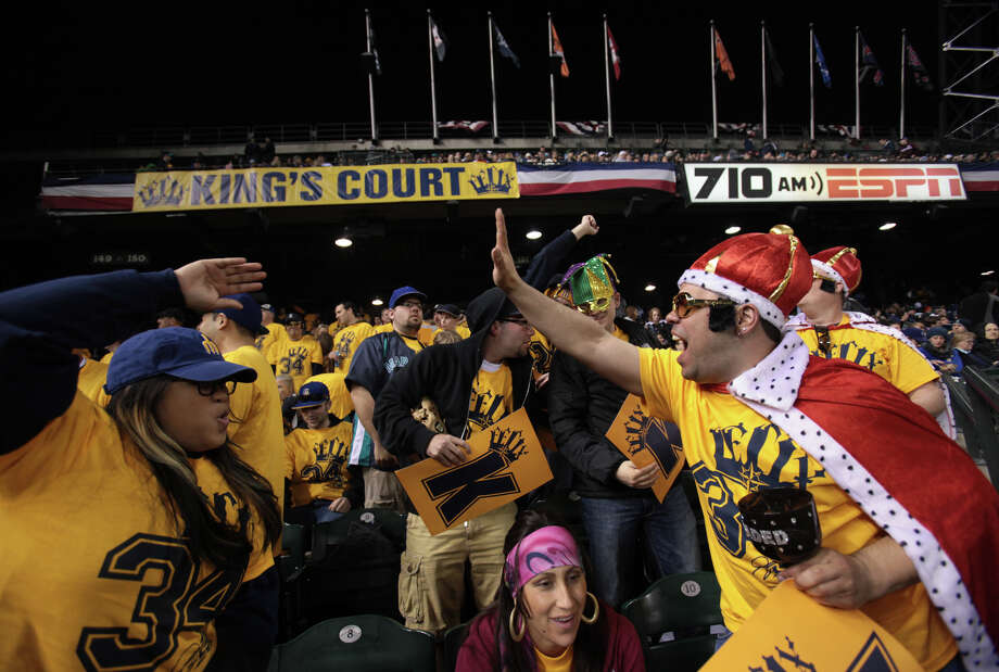 Members of the Felix Hernandez Kings Court , including Tauave Pepe, right, celebrate their team. Photo: JOSHUA TRUJILLO / SEATTLEPI.COM