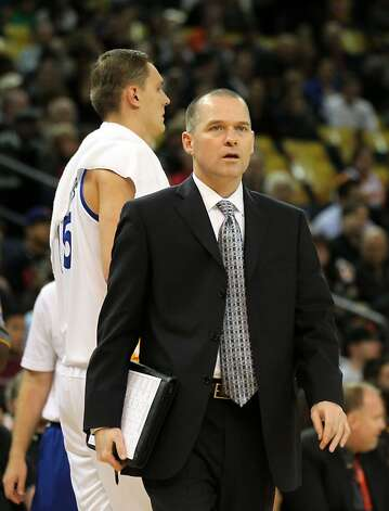 Golden State Warriors' assistant coach Michael Malone walks out onto the court during a timeout with his drawing pad that's used to formulate plays with. The Warriors lost their NBA game to the Dallas Mavericks, Thursday, April 12, 2012, in Oakland, Calif, 112-103. Photo: Lance Iversen, The Chronicle