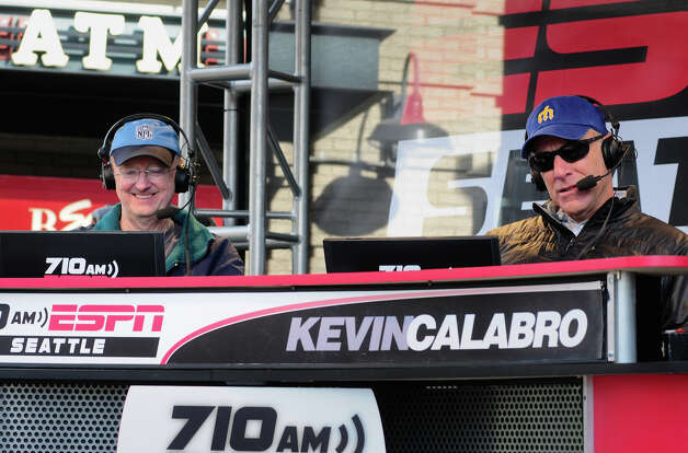 Play-by-play announcer Kevin Calabro, right, of 710 ESPN Seattle, hosts a show from outside Safeco Field's entrances along with NFL expert John Clayton. Photo: LINDSEY WASSON / SEATTLEPI.COM