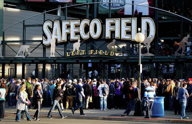 A crowd of baseball fans waits to enter Safeco Field at the left field entrance. Photo: LINDSEY WASSON / SEATTLEPI.COM