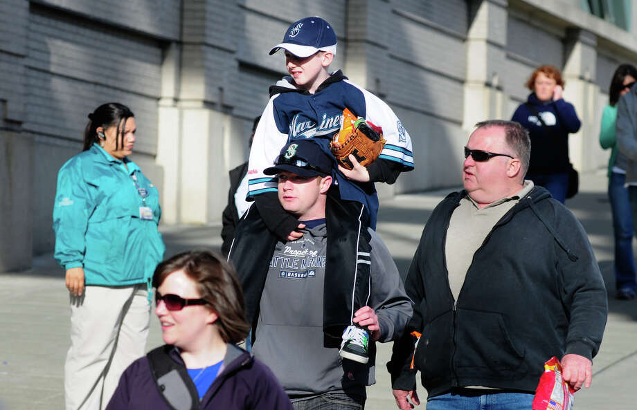 Fans make their way to Safeco Field entrances before the game. Photo: LINDSEY WASSON / SEATTLEPI.COM