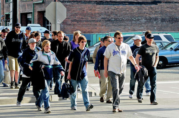A stream of Mariners fans crosses the street to Safeco Field. Photo: LINDSEY WASSON / SEATTLEPI.COM