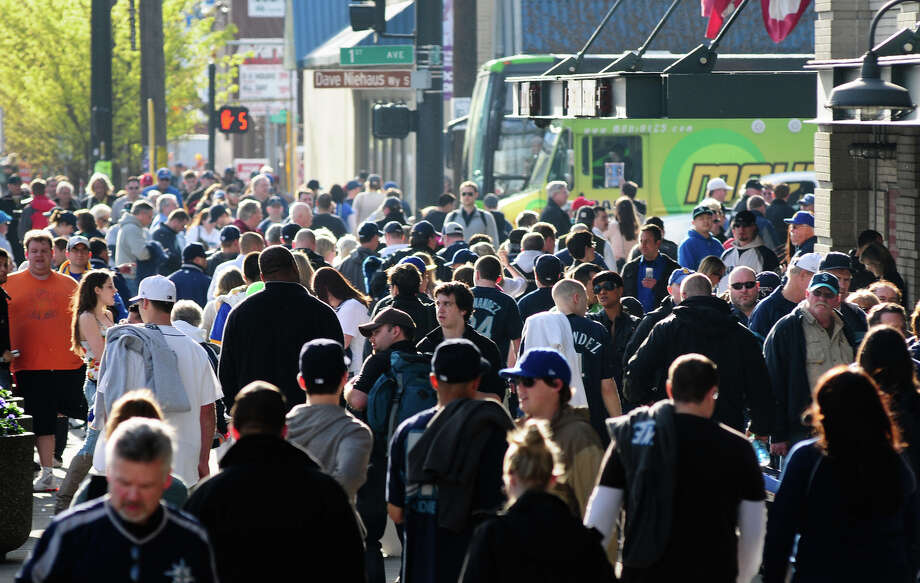 Fans clog the streets outside Safeco Field before the Mariners' home Opening Day on Friday, April 13, 2012. The Mariners returned home after having started their season in Japan and then Oakland, entering tonight's game with a 4-4 record. Photo: LINDSEY WASSON / SEATTLEPI.COM