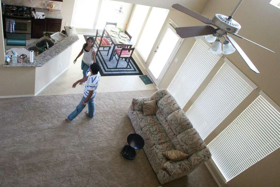 Kaushal and Visha Brahmbhatt, first-time home-buyers, check out their new house. Photo: J. Patric Schneider / Houston Chronicle