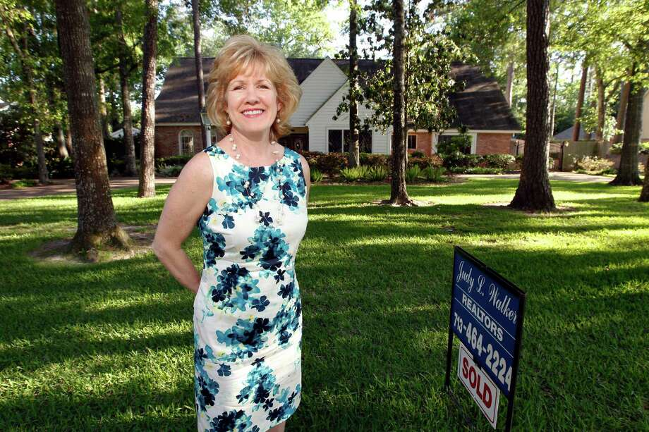 Lea Pipitone poses for a portrait outside her home in 11000 block of Greenbay which was on the market since October and recently sold Thursday, April 5, 2012, in Houston. ( James Nielsen / Chronicle ) Photo: James Nielsen / © 2012 Houston Chronicle