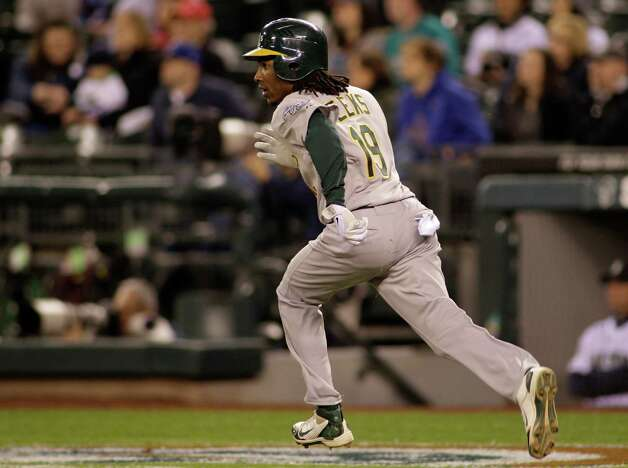 Oakland's Jemile Weeks watches his solo home run in the ninth inning. Photo: AP