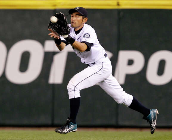 Mariners right fielder Ichiro Suzuki snags a line drive from Oakland's Daric Barton to end the eighth inning. Photo: AP