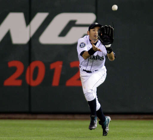 Ichiro Suzuki catches a ball hit by Daric Barton in the eighth inning. Photo: AP