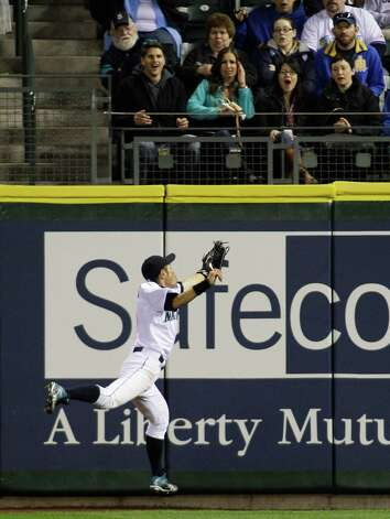 Fans react as Ichiro Suzuki makes a leaping catch of a ball hit by Oakland's Coco Crisp in the seventh inning. Photo: AP