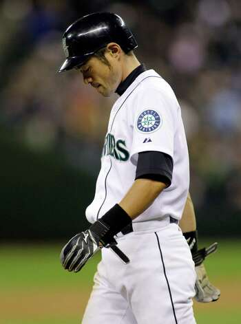 Seattle Mariners' Ichiro Suzuki walks back to third base after a long ball hit by Mariners' Michael Saunders pulled foul in the fourth inning of a baseball game against the Oakland Athletics, Friday, April 13, 2012, in Seattle. Photo: AP