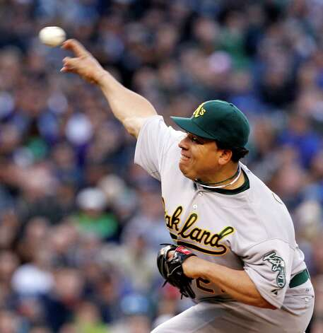 Oakland Athletics starting pitcher Bartolo Colon throws against the Seattle Mariners in the first inning. Photo: AP