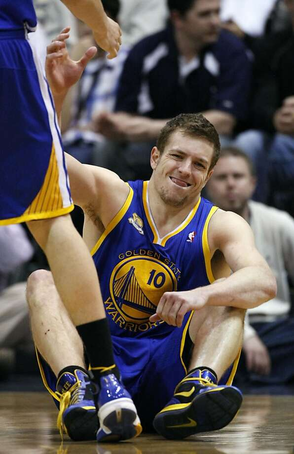 Golden State Warriors power forward David Lee (10) reaches for help up off the court floor after falling during the second half of an NBA basketball game against the Utah Jazz, Friday, April 6, 2012, in Salt Lake City. Photo: Colin E. Braley, Associated Press