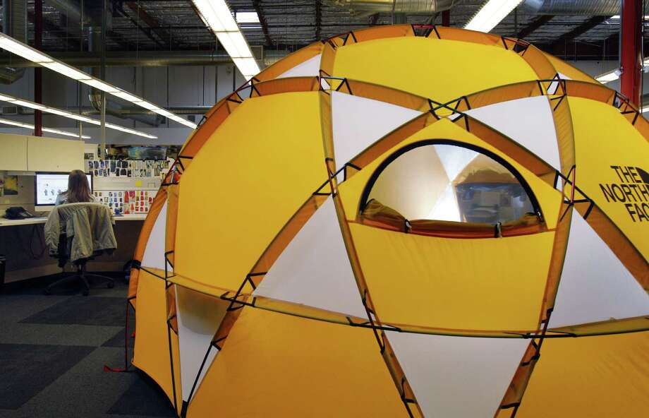 A North Face employee in the footwear and equipment research design and development section works alongside a 2-meter dome tent at the company's San Leandro, Calif., headquarters last month. Photo: Carlos Avila Gonzalez / ONLINE_YES