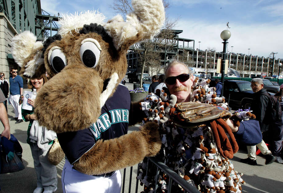 """Moose,"" the Seattle Mariners' mascot, greets George ""The Moose Man"" King outside Safeco Field. Photo: Ted S. Warren / Associated Press"