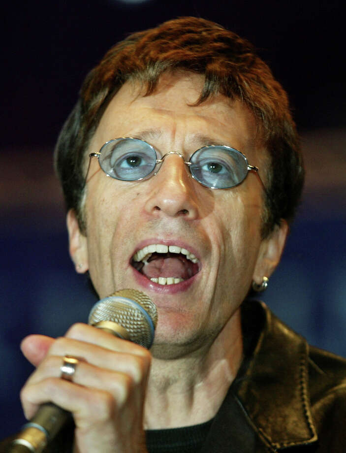 FILE   This Saturday, Sept. 25, 2004, file photo shows former Bee Gees singer Robin Gibb, performing a song at the beginning of a show match between former German tennis star Steffi Graf and Argentina's Gabriela Sabatini at the Max-Schmeling-Halle hall on in Berlin. British media reports said Saturday April 14, 2012 former Bee Gee Robin Gibb is gravely ill with pneumonia in a London hospital. The Sun newspaper reported Saturday that 62-year-old Gibb is in a coma, citing a family friend.(AP Photo/ Jan Bauer) Photo: JAN BAUER, Associated Press / AP