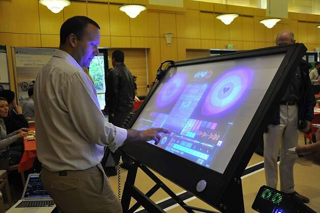 Interactiva Labs' QnQ is a 47-inch touch screen monitor designed to make parties and clubs more interactive. Photo: Erchi Zhang, Special To The Chronicle