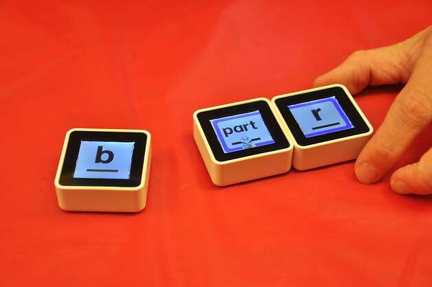 Sifteo cubes are tiny, movable screens that sense when other cubes are around. Photo: Erchi Zhang, Special To The Chronicle