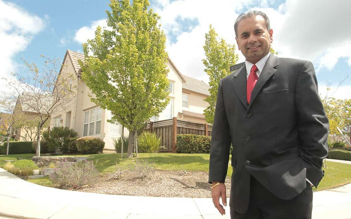 Jagdip Nirwan, a board member of the homeowners association for The Village at Hiddenbrooke, stands in the Thomas Kinkade housing development on Friday, April 13, 2012, in Vallejo, Calif.