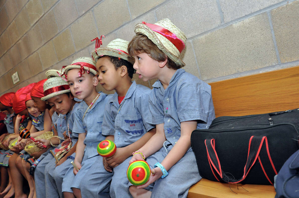 Students line up backstage during the Waterside School International Festival in Stamford on Saturday, Apr. 14, 2012.