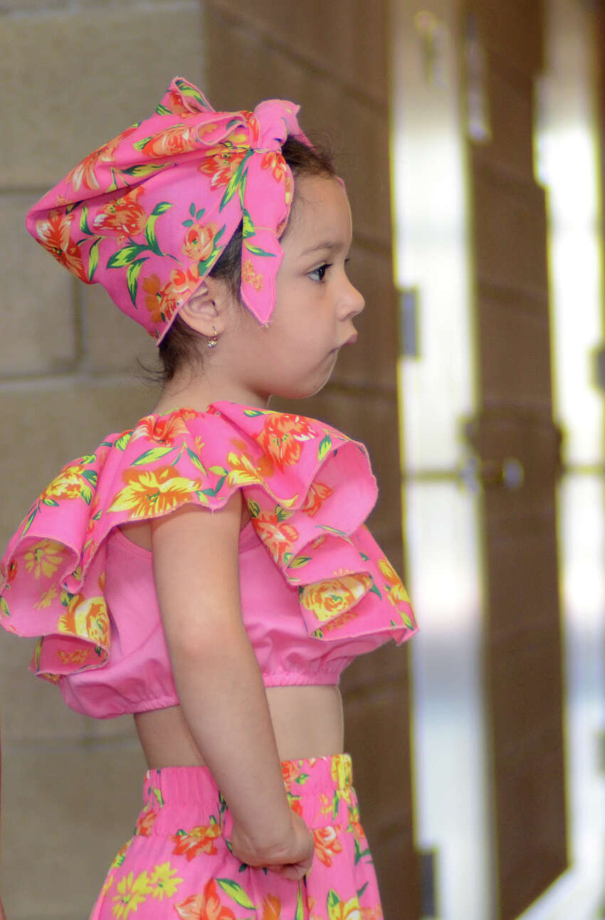 Camilla Benner, 5, junior kindergarten, waits to go on stage to perform an Ecuadorian dance during the annual Waterside School International Festival in Stamford on Saturday, Apr. 14, 2012.