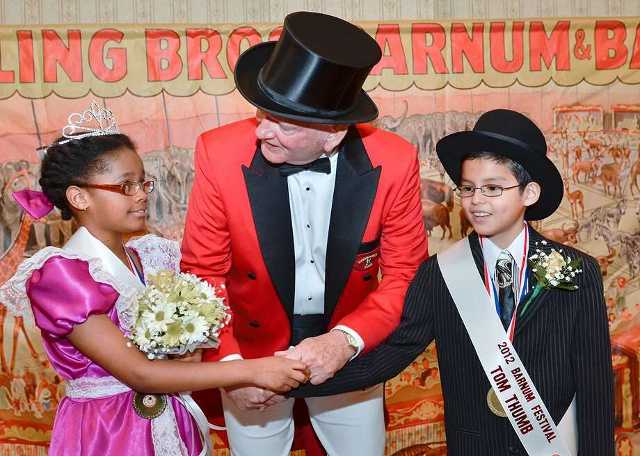 The 2012 Barnum Festival Ringmaster Frank Carroll congratulates Samantha Henry, left and Jorge Urgiles, both of Bridgeport, who were chosen as the 2012 Tom Thumb and Lavinia Warren during a judging event held at the Bridgeport Holiday Inn on Saturday, April 14. Photo: Contributed Photo