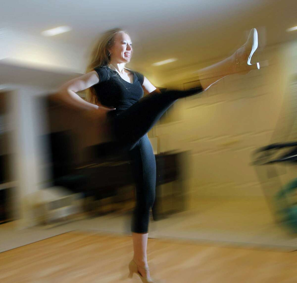 Marisa Hann, 16, works on her dance routine in the basement of her Greenwich home, Friday afternoon, April 13, 2012. Hann, a Greenwich High School student, will be featured in the second episode of MSG Varsity's hit series