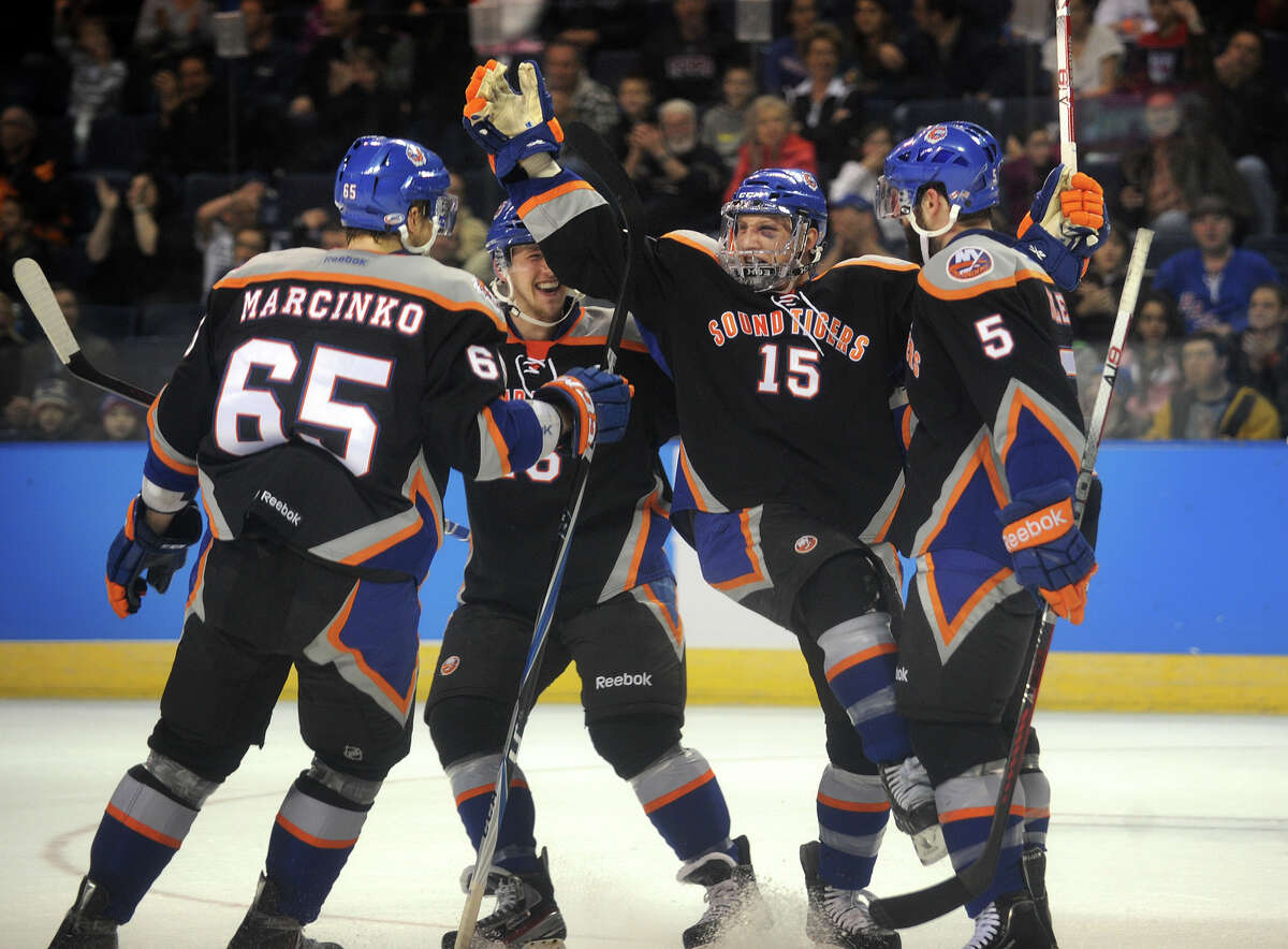 From left; Sound Tiger teammates Tomas Marcinko, Matt Donovan, Steve Oleksy, and Blair Riley celebrate Oleksy's first period, and first career AHL goal, during their matchup with the Connecticut Whale at the Webster Bank Arena in Bridgeport on Sunday, March 25, 2012.