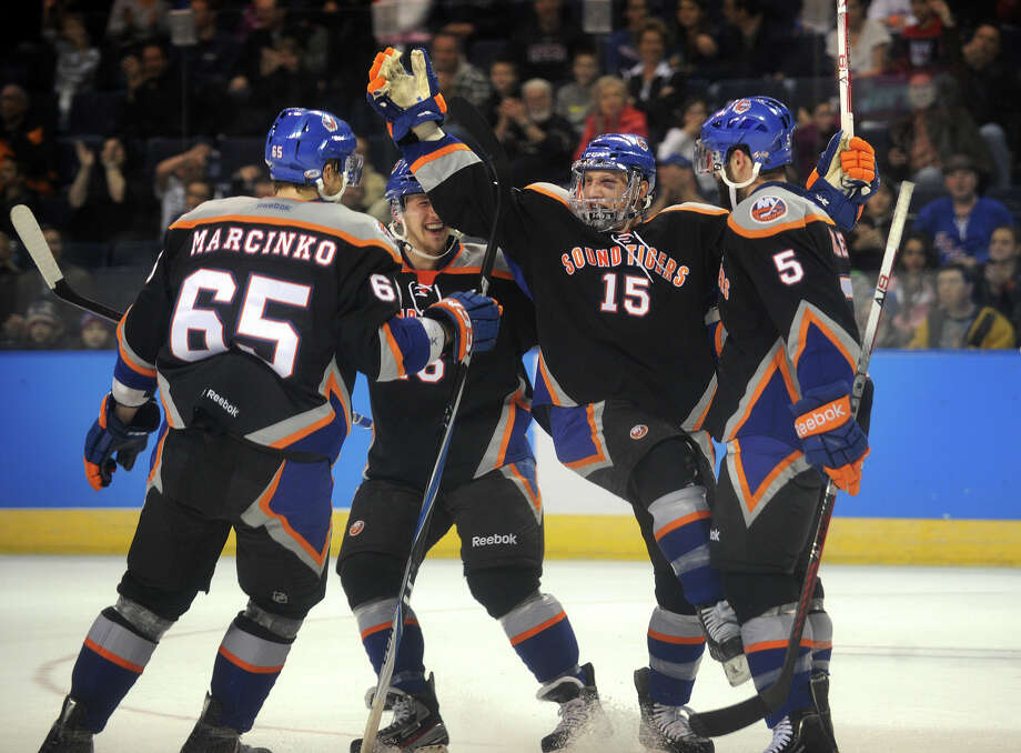 From left; Sound Tiger teammates Tomas Marcinko, Matt Donovan, Steve Oleksy, and Blair Riley celebrate Oleksy's first period, and first career AHL goal, during their matchup with the Connecticut Whale at the Webster Bank Arena in Bridgeport on Sunday, March 25, 2012. Photo: Brian A. Pounds, Brian A. Pounds/Staff Photographer / Connecticut Post