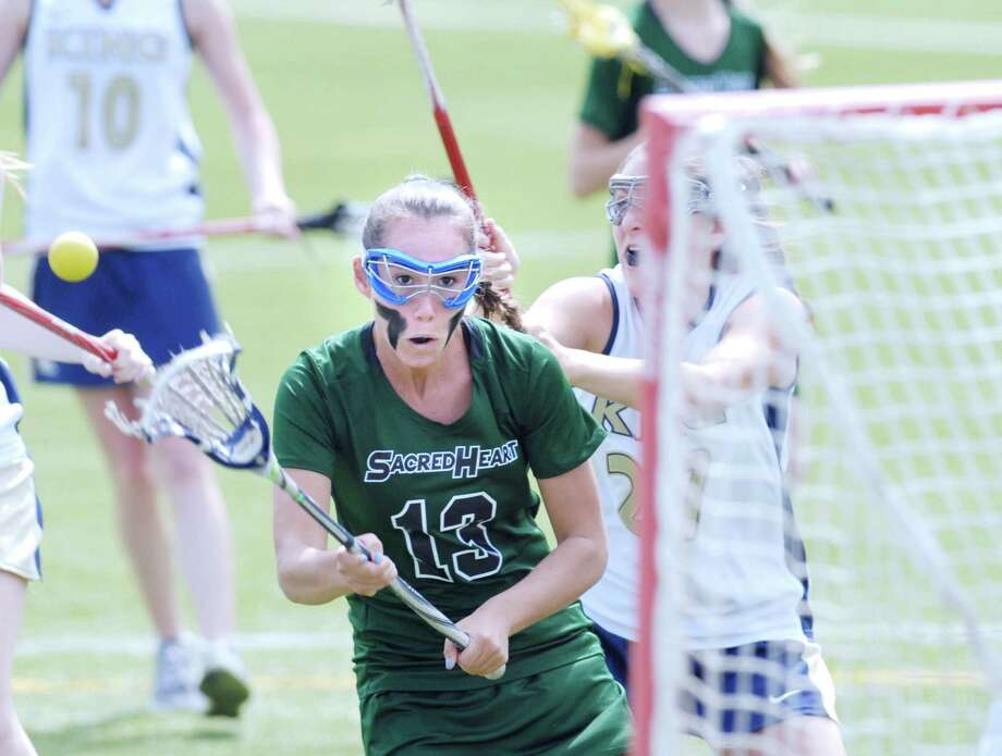 Jen Schwabe #13 of Convent of the Sacred Heart scores during lst half action in the girls high school lacrosse match between Convent of the Sacred Heart and King at Convent in Greenwich, Saturday afternoon, April 14, 2012. Photo: Bob Luckey / Greenwich Time