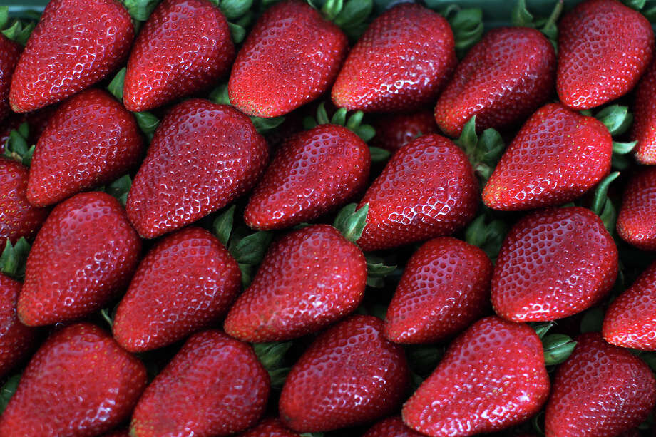 A beautifully packed flat of strawberries during strawberry judging at the Poteet Strawberry Festival, Saturday, April 14, 2012. (JENNIFER WHITNEY) Photo: JENNIFER WHITNEY, SPECIAL TO THE EXPRESS-NEWS / special to the Express-News