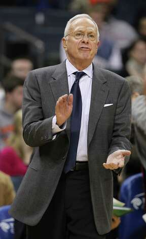 Charlotte Bobcats coach Larry Brown urges his team on in the second half of an NBA basketball game in Charlotte, N.C., Tuesday, Dec. 21, 2010.  Photo: AP
