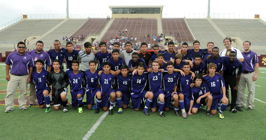 The Morton Ranch Mavericks show off their team trophy after their 1-0 win over the Cy-Ridge Rams in the Boys Region III-5A Final at Abshier Stadium in Deer Park on Saturday. Freelance photo by Jerry Baker Cy-Fair High School (Freelance photo by Jerry Baker) Photo: Jerry Baker, For The Chronicle