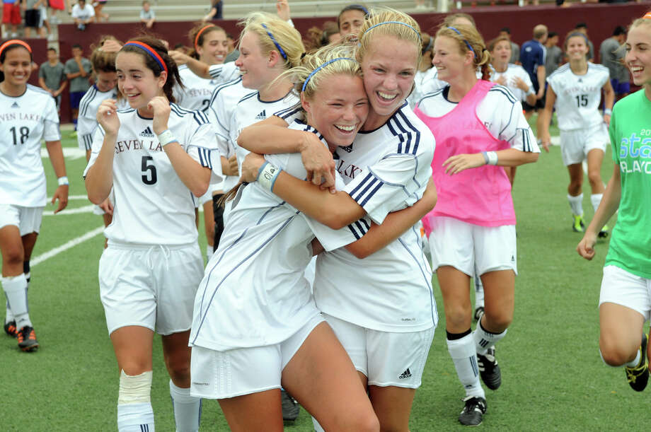 Seven Lakes junior midfielder Shayne Clewett, from left, and junior forward Sarah Eads celebrate the Spartan's shootout win over the Clear Lake Falcons in the Girls Region III-5A Final at Abshier Stadium in Deer Park on Saturday. Freelance photo by Jerry Baker Cy-Fair High School (Freelance photo by Jerry Baker) Photo: Jerry Baker, For The Chronicle
