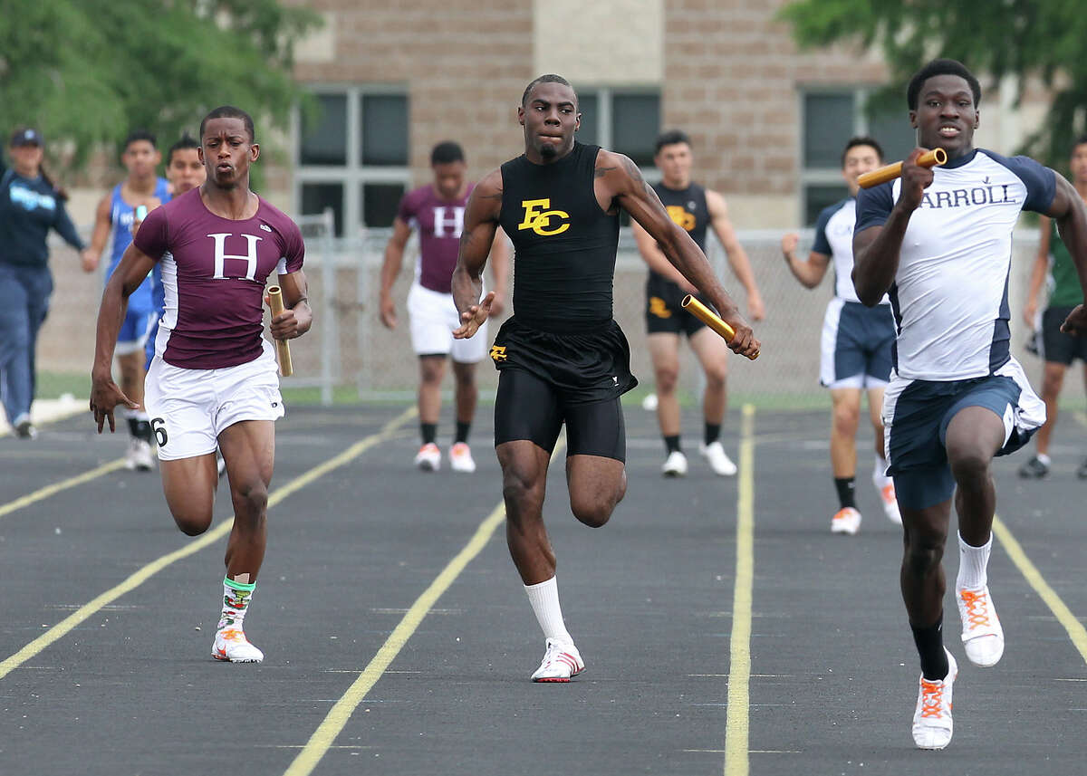 East Central's Kendrick Davis (center) and Highlands' Vernon Lott (left) place second and third respectively for their team in the 400-meter relay at the District 28-5A track meet at East Central High School on Friday, Apr. 13, 2012. Kin Man Hui/Express-News.