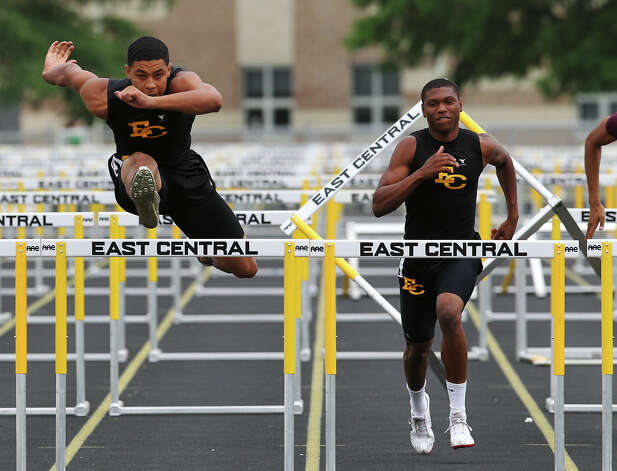 East Central's Austin Jupe (left) finishes first ahead of teammate Chris Armstrong in the 110-meter hurdles at the District 28-5A track meet at East Central High School on Friday, Apr. 13, 2012. Kin Man Hui/Express-News. Photo: Kin Man Hui, Kin Man Hui/Express-News / ©2012 San Antonio Express-News