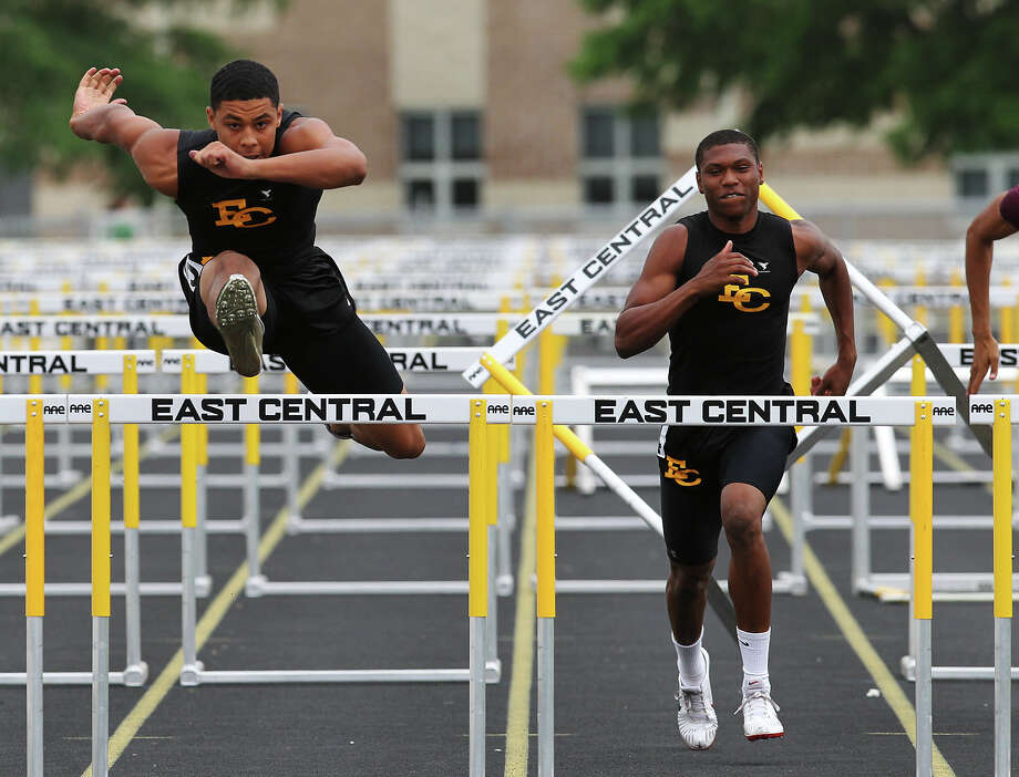 East Central's Austin Jupe (left) finishes first ahead of teammate Chris Armstrong in the 110-meter hurdles at the District 28-5A track meet. Photo: Kin Man Hui, Kin Man Hui/Express-News / ©2012 San Antonio Express-News
