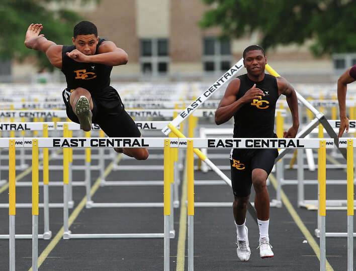 East Central's Austin Jupe (left) finishes first ahead of teammate Chris Armstrong in the 110-met