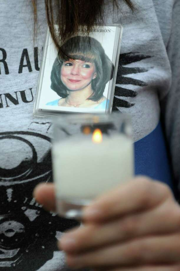 Sonsia Court of Ravena wears a picture of her mother, Audrey Herron, who's been missing since 2002, during a Missing Persons Memorial on Saturday, April 14, 2012, at the Missing Persons Memorial site in Albany, N.Y. (Cindy Schultz / Times Union) Photo: Cindy Schultz / 00017166A