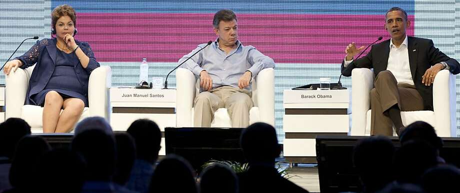 Brazil's President Dilma Rousseff, left, Colombia's President Juan Manuel Santos, center, and U.S. President Barack Obama participate in a three-way conversation at the CEO Summit of the Americas, in Cartagena, Colombia, Saturday April 14, 2012. Regional business leaders are meeting parallel to the sixth Summit of the Americas which brings together presidents and prime ministers from Canada, the Caribbean, Latin America and the U.S. Photo: Carolyn Kaster, Associated Press