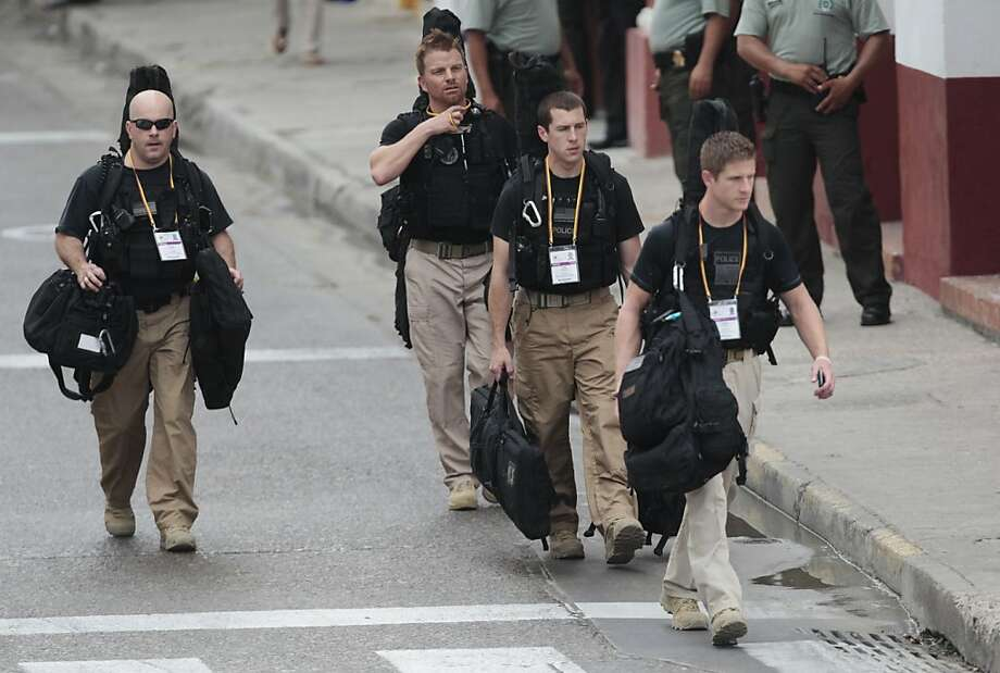 U.S. secret service agents walk around the Convention Center in Cartagena, Colombia, prior to the opening ceremony of the 6th Summit of the Americas at the Convention Center in Cartagena, Colombia, Saturday, April 14, 2012.  Last Thursday, a dozen secret service agents sent to provide security for U.S. President Barack Obama, were relieved from duty and replaced with other agency personnel after an incident of alleged misconduct. Photo: Fernando Llano, Associated Press