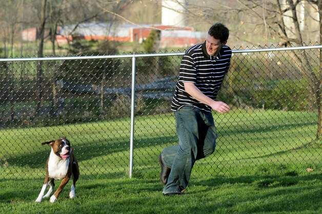 Mark Patterson plays with his boxer, Porter, in his backyard on Friday, April 6, 2012, in Selkirk, N.Y. (Cindy Schultz / Times Union) Photo: Cindy Schultz / 00017119A