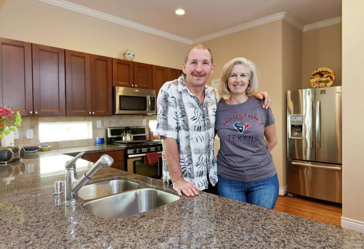 Angelo Poli and Melissa Poli recently moved into their new three-story town home in the Heights at 938 W. 26th Street, Number B. They love the build quality and location. (Still has that new house smell, too.)
