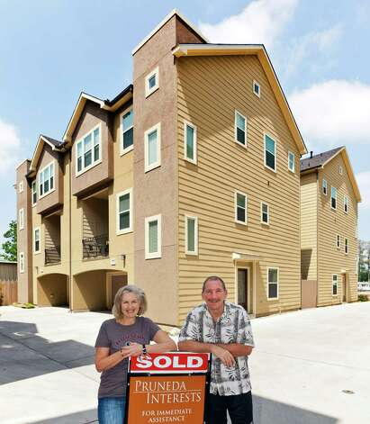 Angelo Poli and Melissa Poli recently moved into their new three-story town home in the Heights at 938 W. 26th Street, Number B. Photo: Craig Hartley / Copyright: Craig H. Hartley