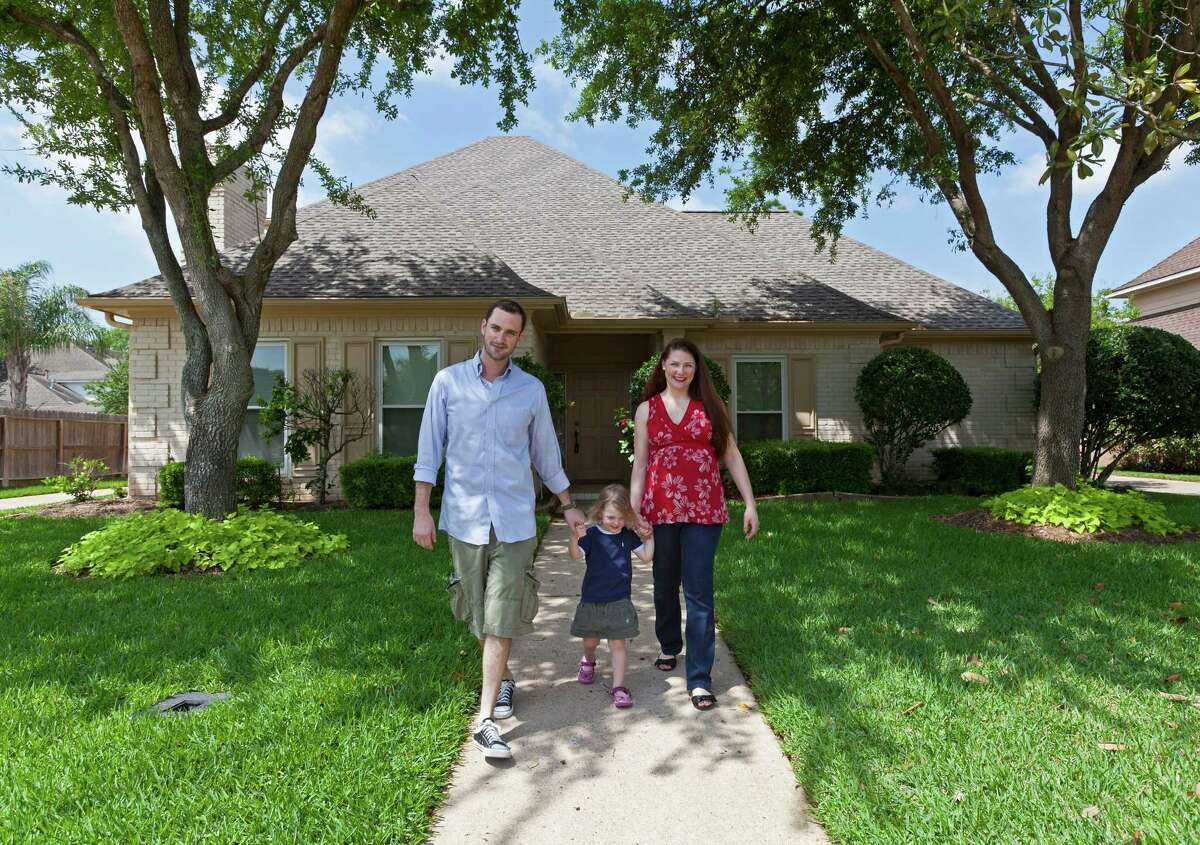 Evan Block and Leah Block, with daughter Stella, 3, looking over and enjoying the yard of their new home in Sugar Land. Their previous home, also in Sugar Land, sold the day it went on the market.