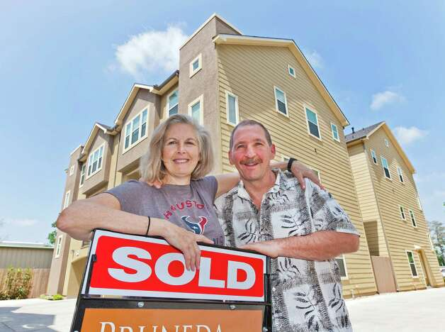 The Polis thought they'd left their real estate problems behind when they moved to Houston from Arizona, but discovered demand for homes was heated in the neighborhoods close to downtown where they were looking. Photo: Craig Hartley / Copyright: Craig H. Hartley
