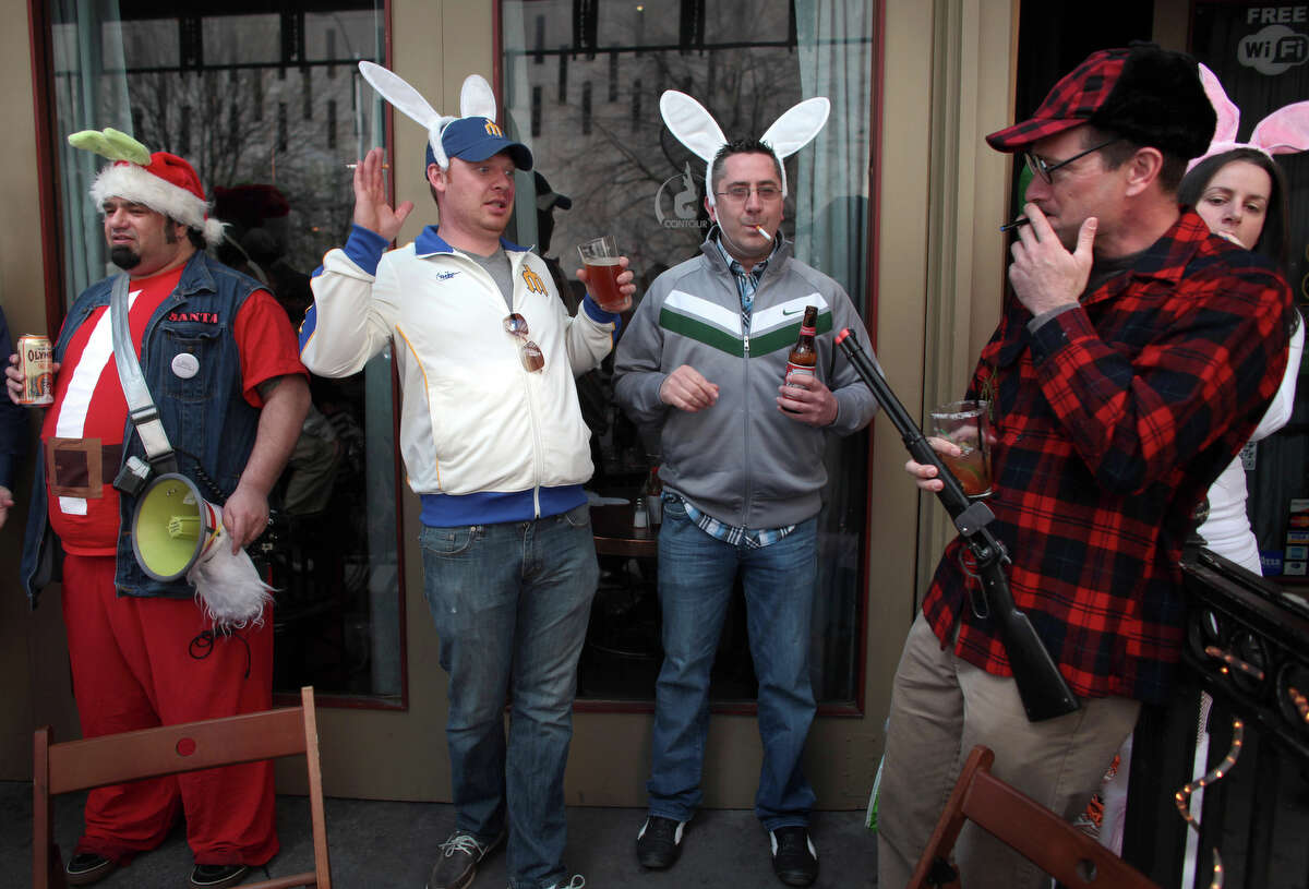 Will Anstey, right, dresses as Looney Tunes character Elmer J. Fudd, known for hunting rabbits, during Bunnarchy, a bar hop for revelers dressed as bunnies. The