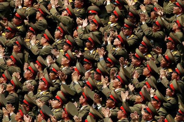 New North Korean leader praises father in first public speech