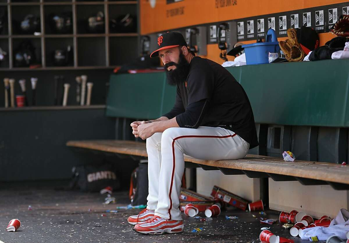 Brian Wilson #38 of the San Francisco Giants sits in the dugout during their game against the Arizona Diamondbacks at AT&T Park on September 4, 2011 in San Francisco, California.