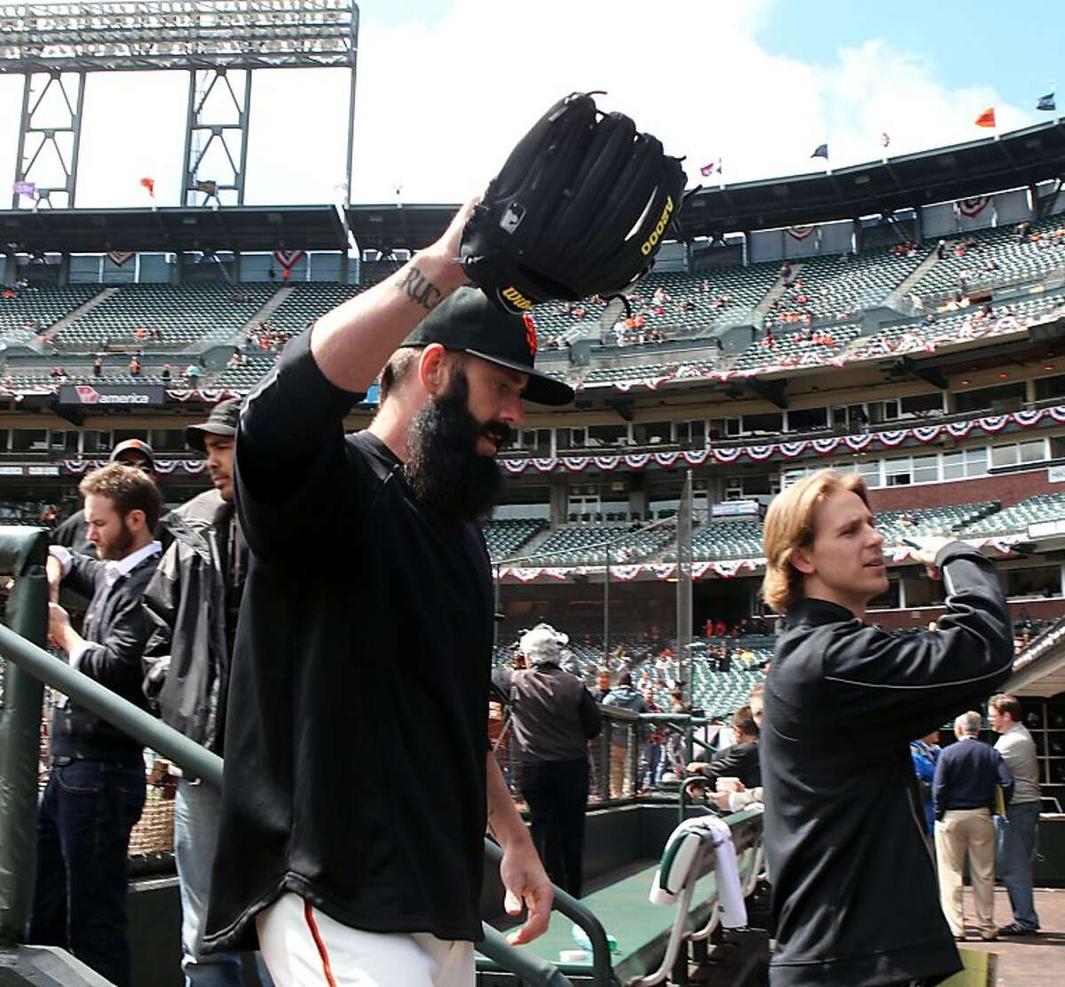 San Francisco Giants relief pitcher Brian Wilson waves to the fans after warming up for their game with the Pittsburgh Pirates Friday, April 13, 2012, in San Francisco Calif.